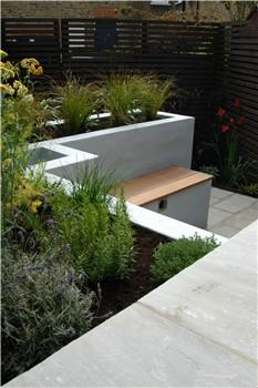 design for a very narrow london garden in built seating viewed from the bar