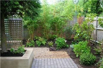 Breeze Garden Design A formal pond and planting in a garden in